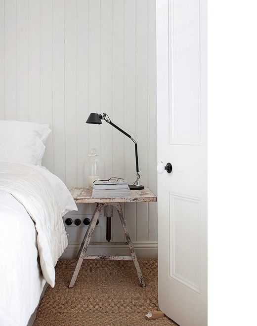 Industrial side table, modern lamp. Great idea for a bedside candle...a little safer than an open flame in case you fall asleep.