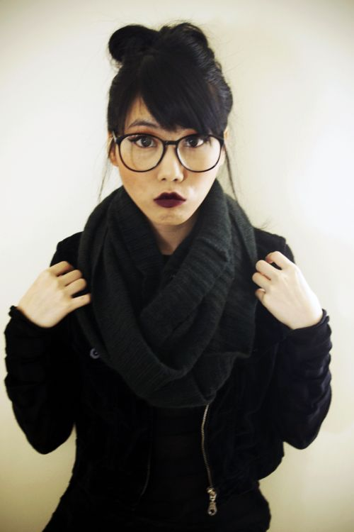 all black bun bangs glasses dark lips