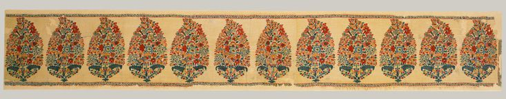 Through the eighteenth century, the ever popular flowering plants of the Shah Jahan period transformed into pinecone-shaped clusters of buds emanating from roots of stylized leaves. Here, the motif, called a bota, lines the edge panel of a shawl. Object Name: Panel from a shawl  Date: first half 18th century  Geography: Attributed to India, Kashmir  Medium: Pashmina wool; double interlocking twill tapestry weave  Dimensions: Textile: L. 8 5/8 in. (21.9 cm) W. 59 7/8 in. (152.1 cm)