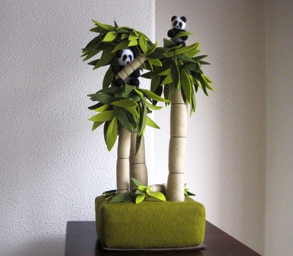 Clump of bamboo trees with two pandas  It's a group of 3 bamboo trees with a platform of foam to assure the stability of the set. Two pandas, two small branchs of bamboo and some leaves.  Pandas are made with the technique of needle felted.