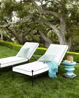 #ONLYATNM Only Here. Only Ours. Exclusively for You. Classic black and white outdoor chaise. Steel frame and aluminum finials with powder-coated finish. Cushions covered in polyester fabric and filled