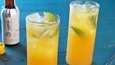 """The foundation of this orange-flavored cocktail is San Pellegrino's sparkling beverage Aranciata. Aromatic bitters and a little rum complete this fruity drink. From the book """"Lucinda's Rustic Italian Kitchen,"""" by Lucinda Scala Quinn (Wiley)."""