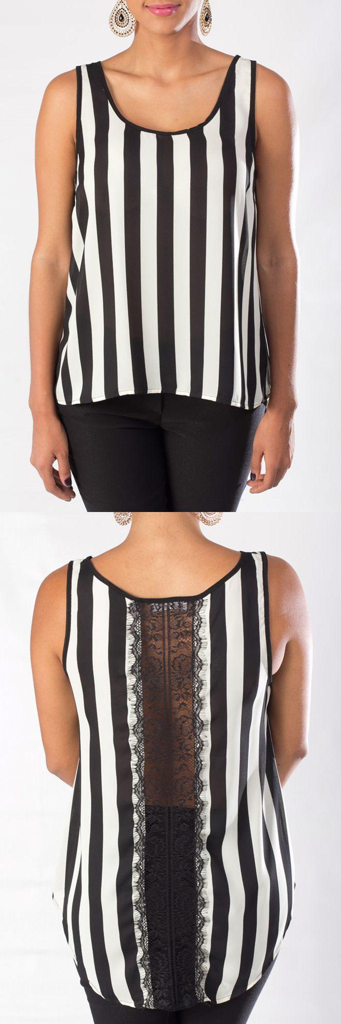 Blusa sin mangas en color negro y blanco con un delicado escote en la espalda.