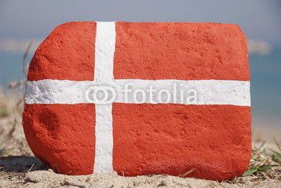 Denmark flag 2 on a stone over the sand