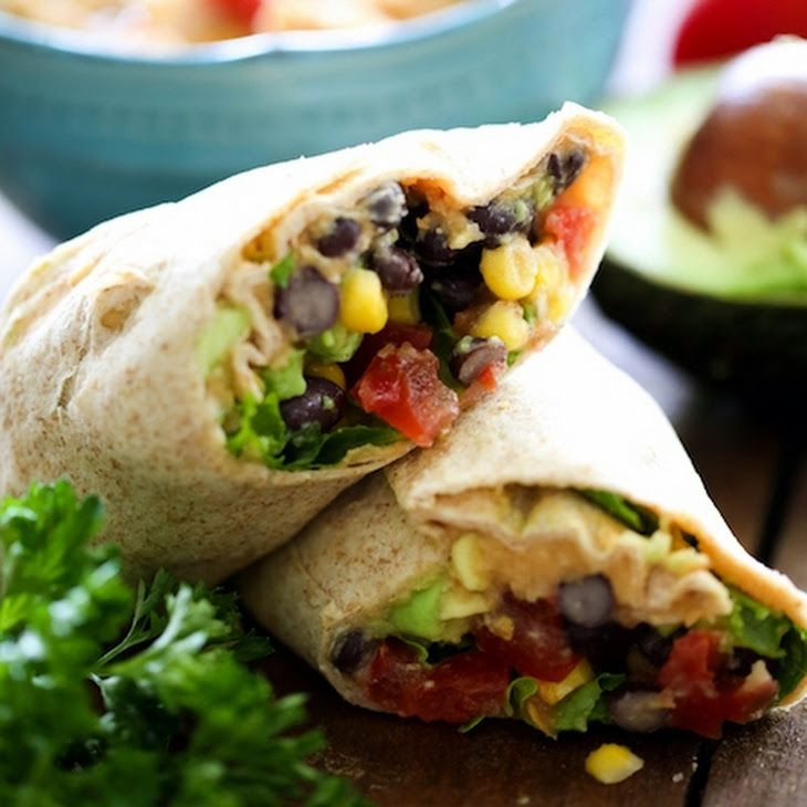 Southwest Hummus Wraps Recipe Lunch and Snacks with tortilla wraps, hummus, corn, black beans, diced tomatoes, avocado, shredded lettuce