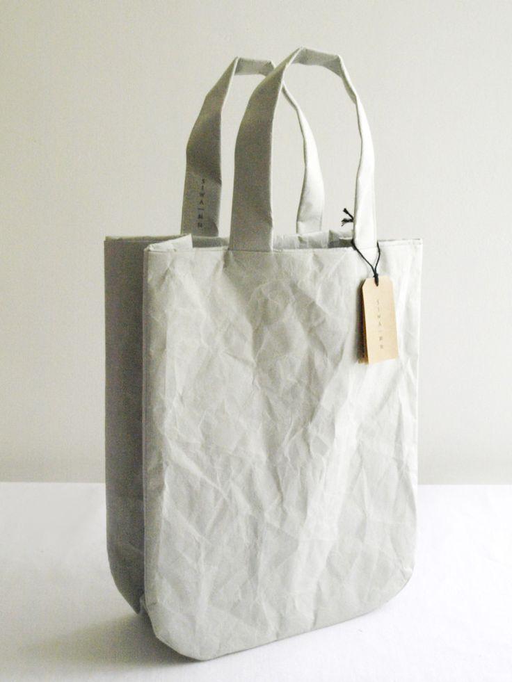 "SIWA round bag, soft naoron (paper made of wood pulp and polyolefin using ""washi suki"" paper manufacturing process)."