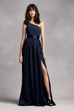 Timeless and chic, this floor sweeping dress draws a romantic appeal! One shoulder dress with crepe bodice features a flattering trapunto satin sash at the waist. Long soft matte charmeuse skirt with side slit. Sizes 0-26. Fully lined. Back zip. Imported. Dry clean only. $189