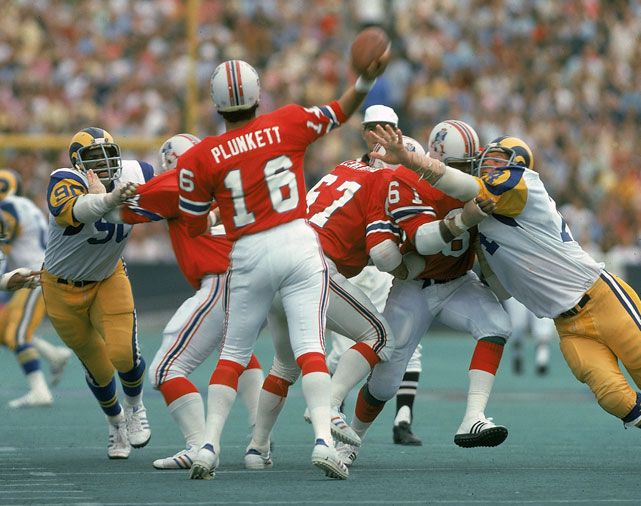 Patriots quarterback Jim Plunkett looks for an open receiver during a 1974 game against the Rams at Foxboro Stadium. SI's Don Banks has made his AFC East predictions and New England, who has finished first nine of the past 11 years, is in position to make another Super Bowl run. (Neil Leifer/SI)  BANKS: Patriots favored to win AFC East yet again  Notes on all 32 NFL teams