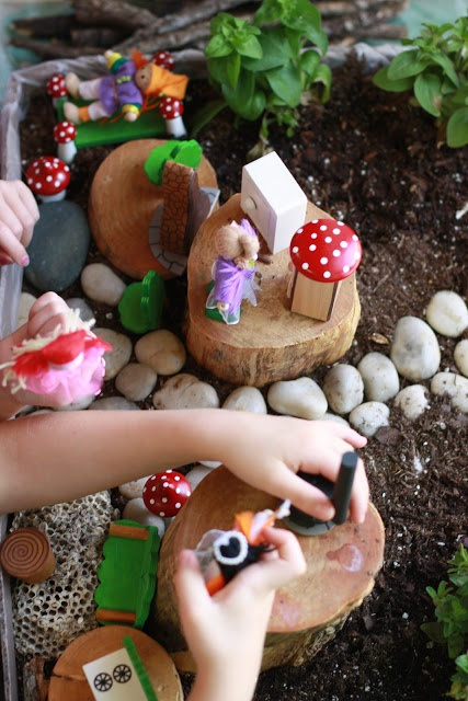 """There is an indoor garden bed.  Children collect natural objects (rocks, moss, abandoned bees nests, etc.) to create a """"living doll house"""" with plants growing around..."""