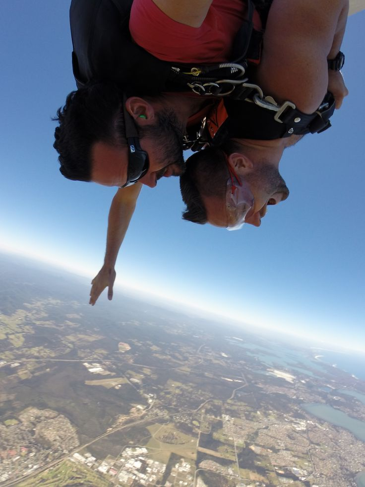 Tandem skydivers flying face-first through the air in Sydney. Our highly qualified instructors will be with you all the way. #SkydiveAustralia #tandemskydiving #fun #skydive #adrenaline