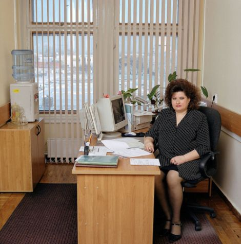 Russia, bureaucracy, Siberia, province Tomsk, 2004. Russia-19/2004 Marina Nikolayevna Berezina (b. 1962), a former singer and choir director, is now the secretary to the head of the financial department of Tomsk province's Facility Services. She does not want to reveal her monthly salary.