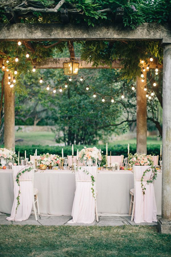 Romantic Outdoor Wedding Reception with Garland Chair Decor and Twinkle Lights | Sonya Khegay Photography | http://heyweddinglady.com/playful-elegance-pastel-peach-pink/