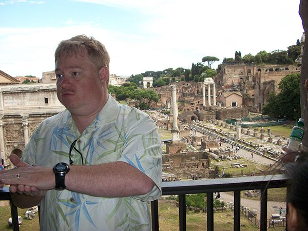 Instructor Chris dePagnier lecturing students overlooking areas in Rome Italy.