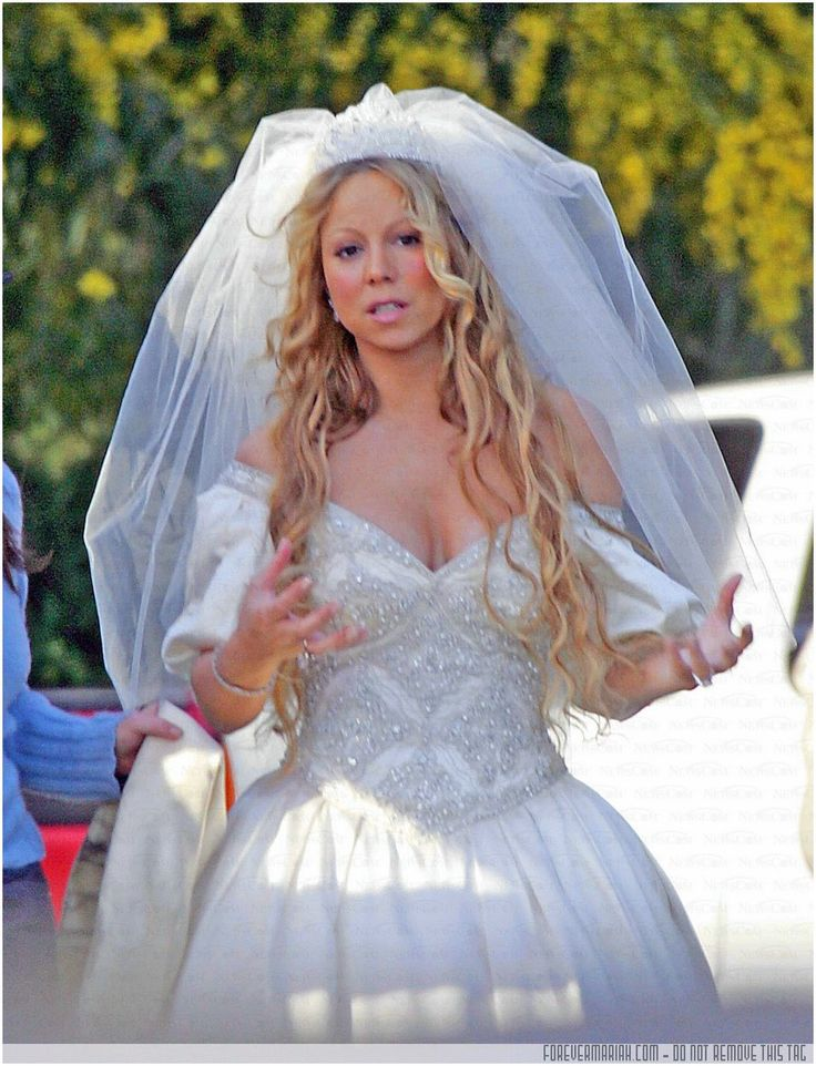 Mariah in the video We Belong Together wearing the dress she wore to her wedding to Tommy Mottola