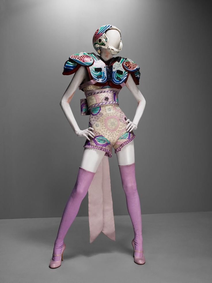 It's Only a Game, spring/summer 2005  Bodysuit and obi-style sash of lilac silk satin and chiffon embroidered with silk thread; shoulder pads and helmet of fiberglass painted with acrylics  Courtesy of Alexander McQueen