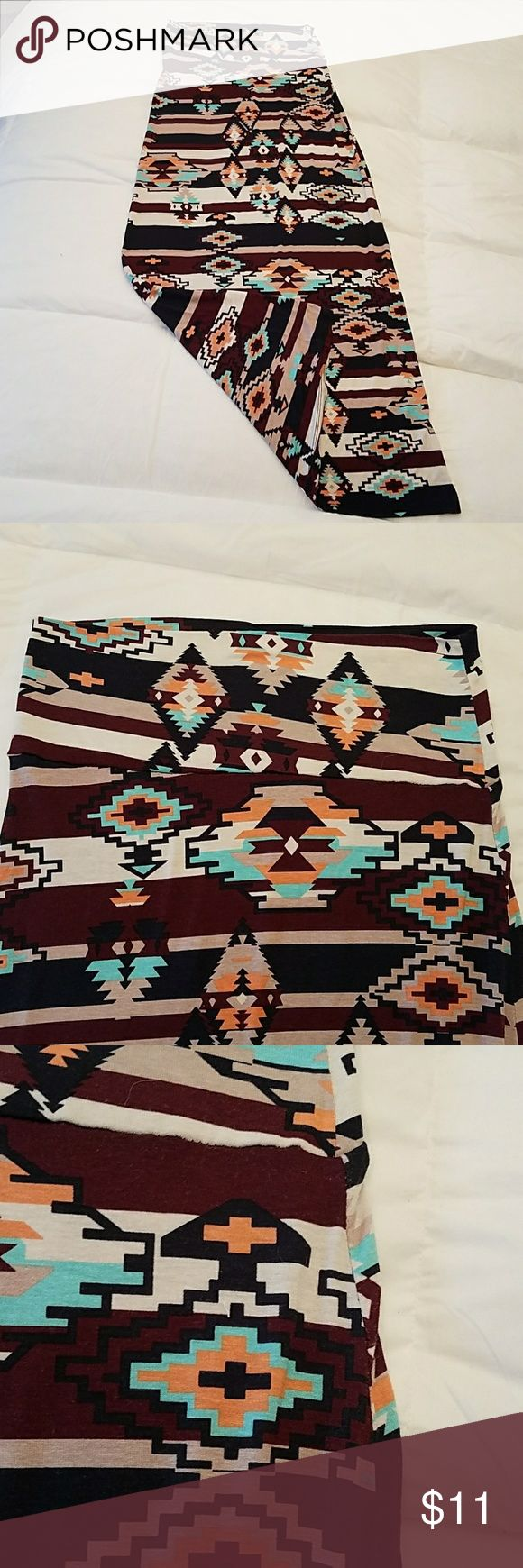 Rue 21 Aztec print maxi skirt size small Rue 21 Aztec print maxi skirt size small. Very comfy long maxi skirt with an Aztec print in 10 blue orange and burgundy brownish colors, throw it on with a T-shirt and a pair of flip-flops and you're ready for your weekend, shorter ladies might even be able to pull it all the way up and wear it as a dress or cover up for the beach. 🌴 Rue 21 Skirts Maxi