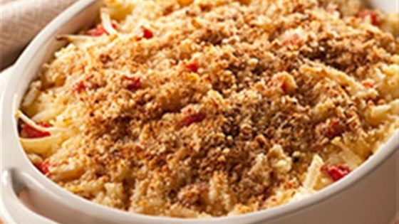 Shredded hash brown potatoes in a creamy base with pepper Jack cheese and roasted red peppers make a delicious dinner casserole that will feed a crowd.