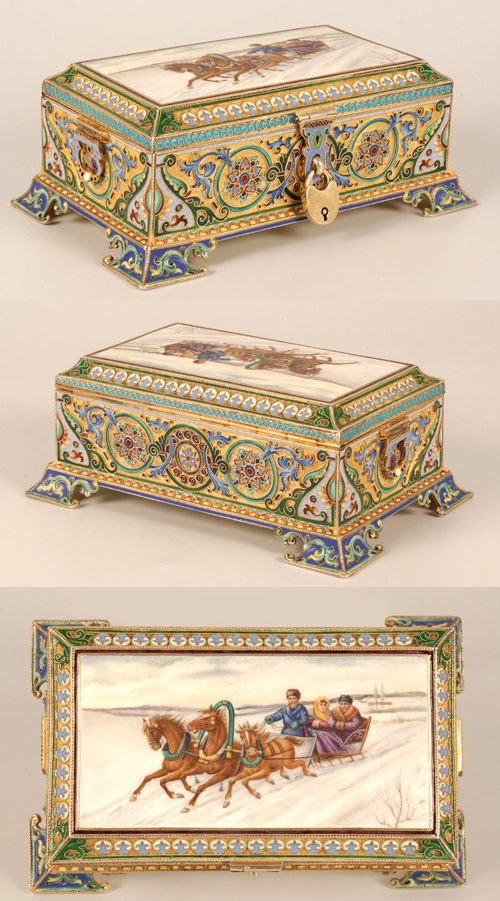❤ -A Russian silver gilt, cloisonne, and en plein enamel casket, 11th Artel, Moscow, 1908-1917. Oblong, on four bracket feet, the sides with roundels enclosing multi-color stylized flower-heads among foliate scrolls, the corners with stylized flowers against a light blue ground, the hinged lid with a matte en plein enamel plaque depicting a troika in a winter landscape within a geometric motif border, the interior of the cover enameled in translucent turquoise over a wavy guilloche ground.