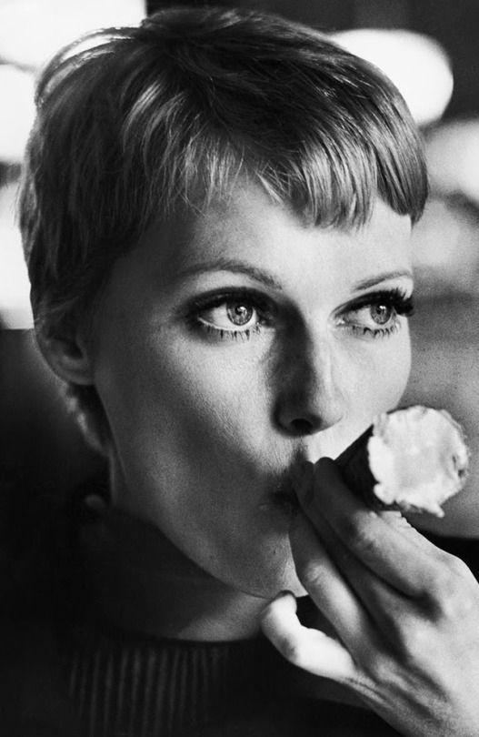 Mia Farrow eating an ice cream cone, 1960s