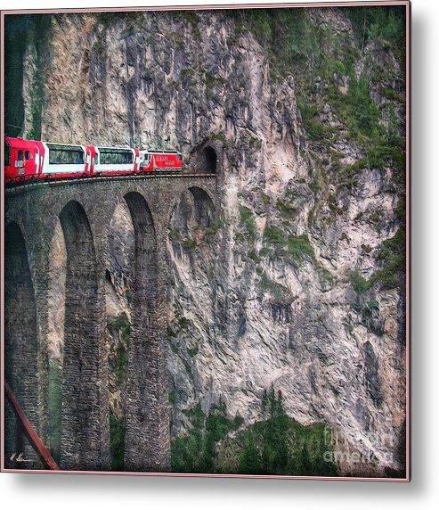 Switzerland Metal Print featuring the photograph Rock Wall With Rockhole, The Landwasser viaduct is a swiss railway over crossing on the Glacier-Express route. The viaduct is located in grisons and it belongs to the UNESCO World Heritage since 2008. The Glacier-Express is a panorama train, running from Zermatt to St. Moritz !  -  Photo by Hanny Heim, Snowbird Photography #switzerland #viaduct #glacierexpress #railway #train #bridge