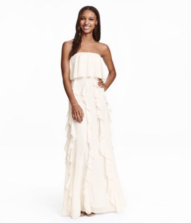 Natural white. Long dress in crinkled chiffon with detachable, adjustable shoulder straps. Silicone trim inside upper edge, boning in sides of bodice, wide