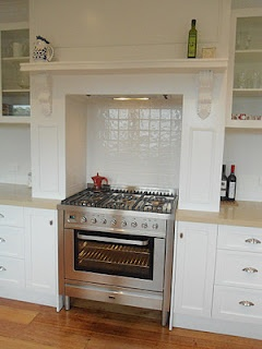 This mantle framed stove area is perfect-sides could pull open for spice storage (see other pin)