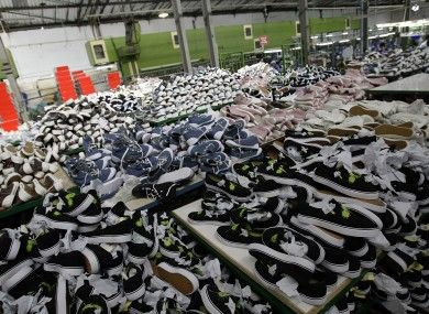 This picture shows one of the more positive aspects of sweatshops. You are able to get shoes for a small amount of money.