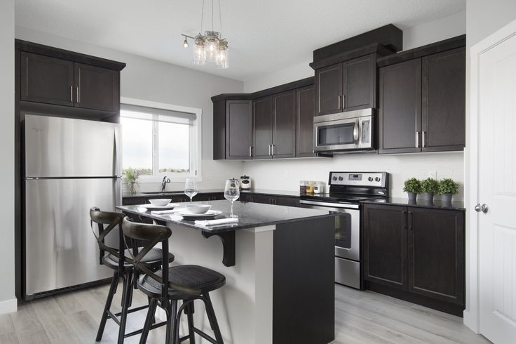 Kitchen in Creations by Shane Homes Samara Showhome in Midtown in Airdrie #kitchen #GraniteCounters #StainlessSteelAppliances