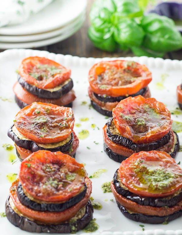 Eggplant and Tomato Stacks - An easy a make ahead veggie side dish. Roasted eggplants and roasted tomatoes layered with a basil pesto vinaigrette.
