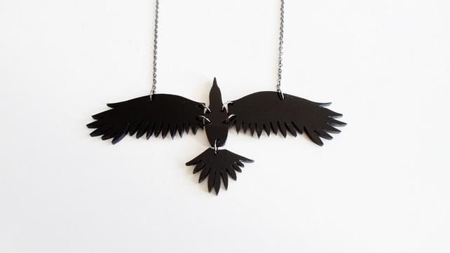 This stunning outstretched raven necklace is part of our new Nevermore Collection. It is intricately cut from 4 sections of black acrylic sheet and secured together with jump rings. The separate joined sections provide a beautiful tactile element to the piece. It measures a huge 4 inches in length and is suspended from a 16 inch oxidised trace chain.  Your purchase will be gift wrapped ready for giving or as a treat for yourself.