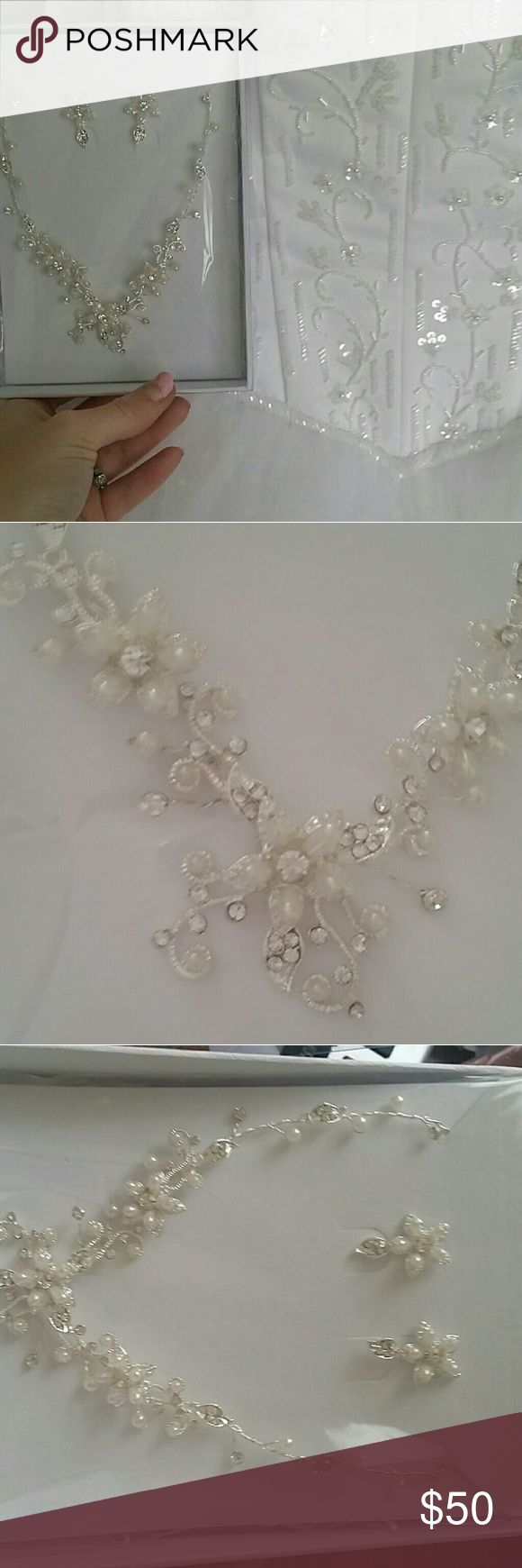 Wedding jewelry set matches veil and dress.. Wedding jewelry set matches veil and dress that's in my closet also for sale. Brand new never even opened out of package. David's Bridal Jewelry