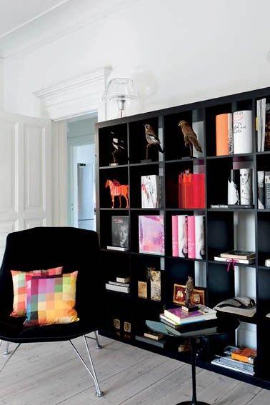 black bookshelves against a white wall