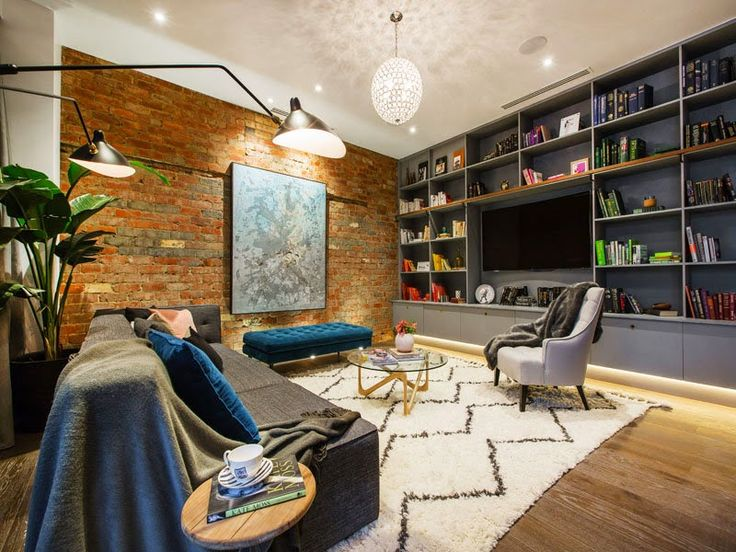 Lounge and living retro glam brick feature wall  - Michael and Carlene's Block Apartment