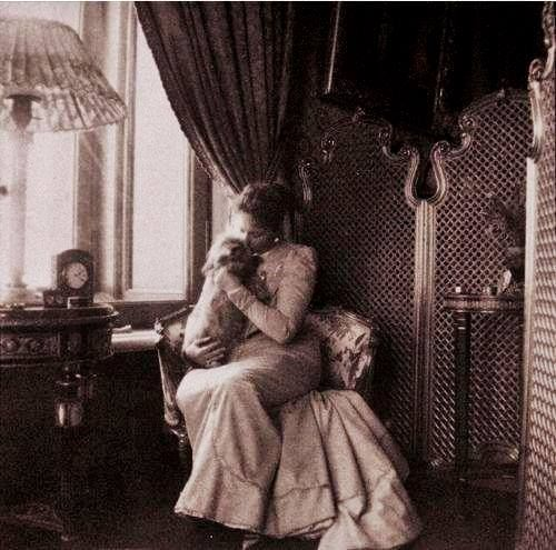 """""""Unlike Nicholas, who wrote painstakingly and sometimes took hours to compose a letter, Alexandra wrote voluminously, dashing off lengthy sentences across page after page, punctuating only with dots and dashes and exclamation points. At her feet, while she wrote, lay a small shaggy Scotch terrier named Eira. Most people considered Eira disagreeable; he liked to dart from under tables and nip at heels. Alexandra doted on him and carried him from room to room — even to the dinner table."""""""