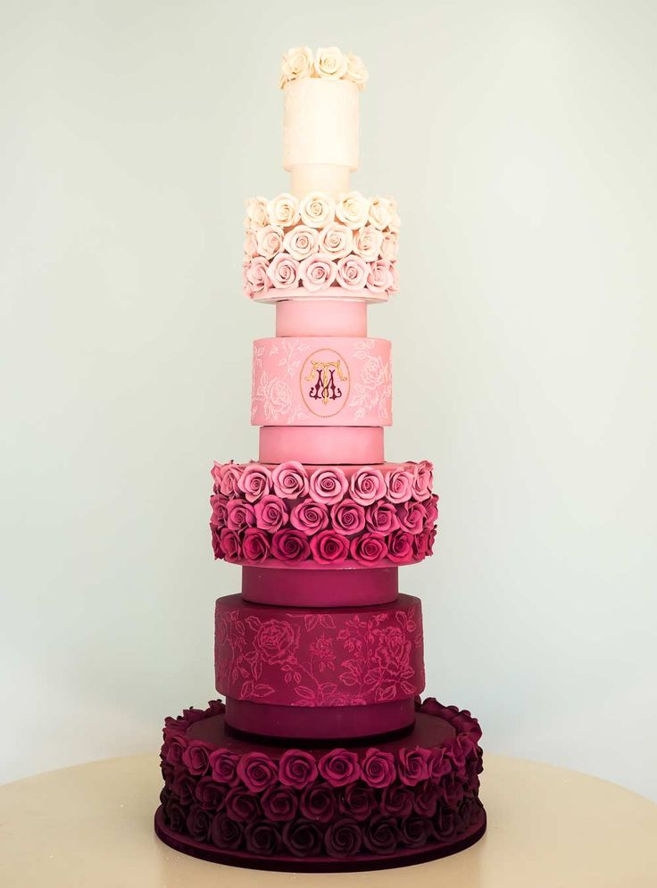 Made by Rosalind Miller, each tier of this unusual wedding cake has been separated for extra height - we love the lace decoration