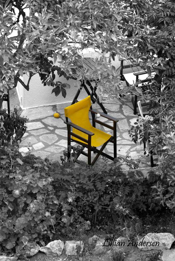 The yellow chair skiathos greece · colour yellowgrey yellowsplash photographyblack white