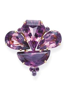 AN AMETHYST AND GOLD BROOCH  Designed as a vari-cut amethyst sylized foliate cluster, mounted in gold, circa 1945