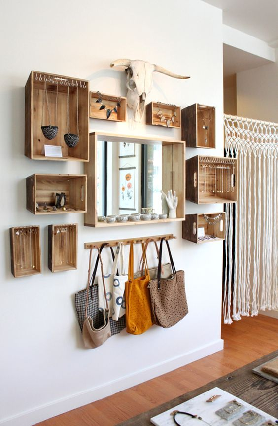 Old crates can be used as shelving to create an eclectic hallway. Love the skull at the top!: