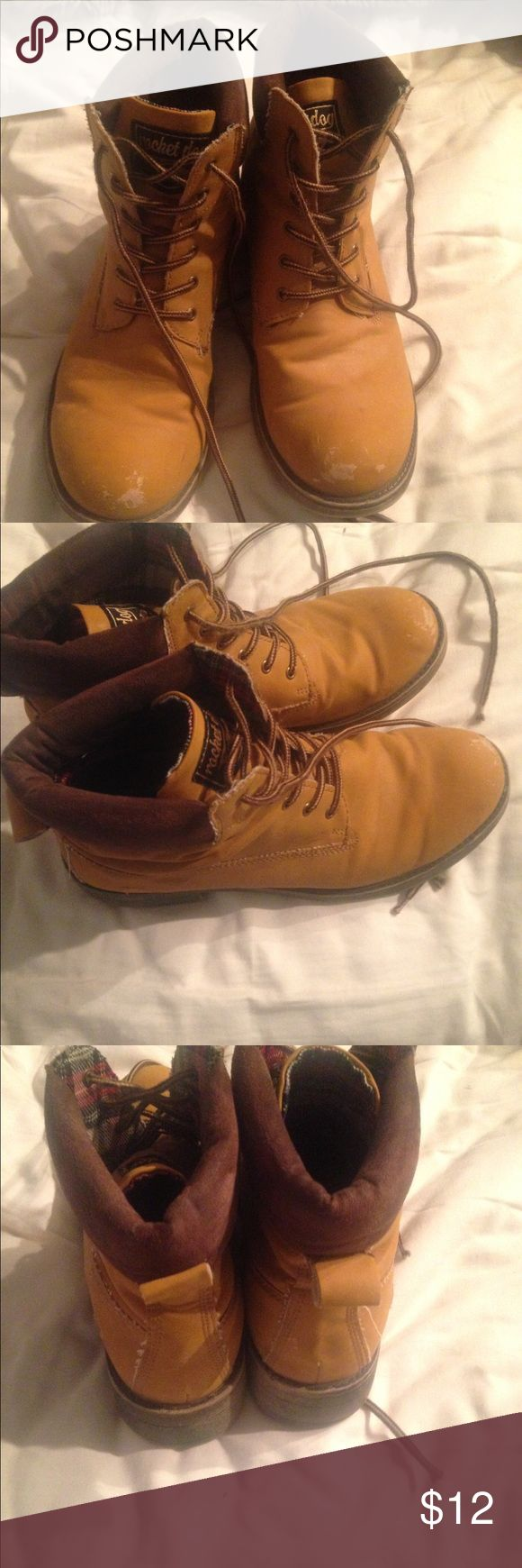 Rocketdog Combat/Work boots Good condition, slight scuffing on the toe. Used as work boots and cute combat boots to wear with jeans. Similar look to Timberlands. Durable faux leather exterior and cotton fabric interior. Inside is red and green plaid. Laces are new. Super comfortable and great for an edgy look. Size 9, but fits small like 8-8.5. Priced for fast sale. Need the closet space! Rocket Dog Shoes Lace Up Boots