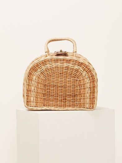 """That PTO isn't going to take itself. Wicker woven picnic style handbag with closure. KAYU, meaning """"wood"""" in Malay, is an ode to the commitment to using natural materials like straw, wood and shell. Kayu's accessories are created by artisans from Thailand, the Philippines, Indonesia and Malaysia. Each piece is handcrafted in limited batches using old school techniques fused with modern design.  Measurements: 10""""L x 5""""w x 7.5"""" H"""