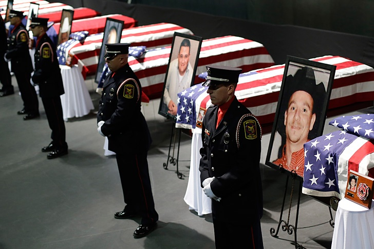 Honor guard stand in front of caskets prior to a memorial service for first responders who died in the fertilizer plant explosion in West, Texas. Wrote a story about one honor guard...