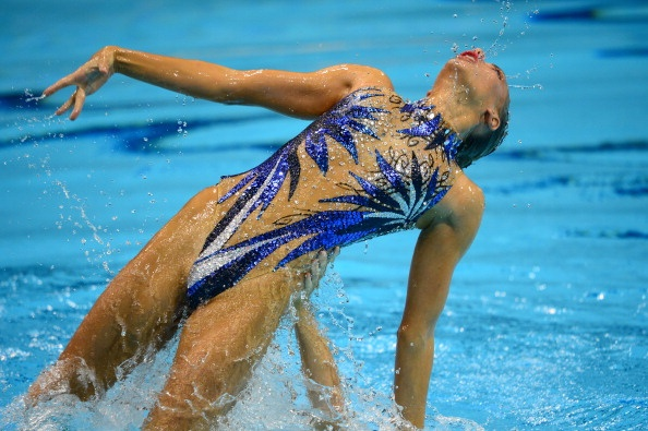 Synchronized Swimming Style: An Appreciation Post: Britain's Jenna Randall has possibly the most naked suit we've seen yet. We don't even wanna know how often she has to visit her waxer.
