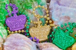 A Mardi Gras party wouldn't be a Mardi Gras party without a King Cake. Read the full history of king cake, why New Orleans king cake is still preferred by many and all about the king cake tradition That starts on Epiphany! Purple for Justice, Green =Faith, Gold for Power.