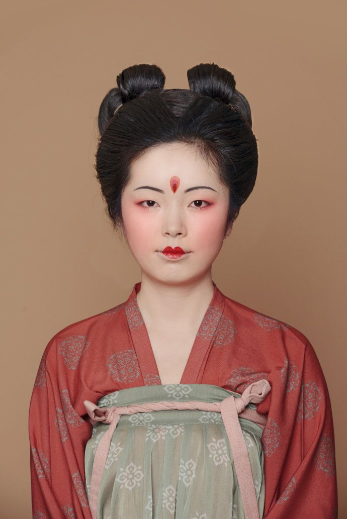 Asia | Portrait of a young woman wearing traditional clothes and a Tang Dynasty style make-up, China