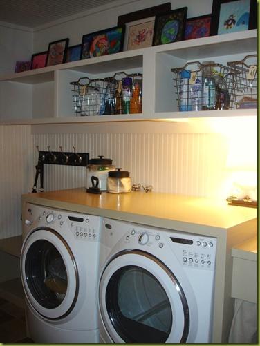 kids art work display in laundry room