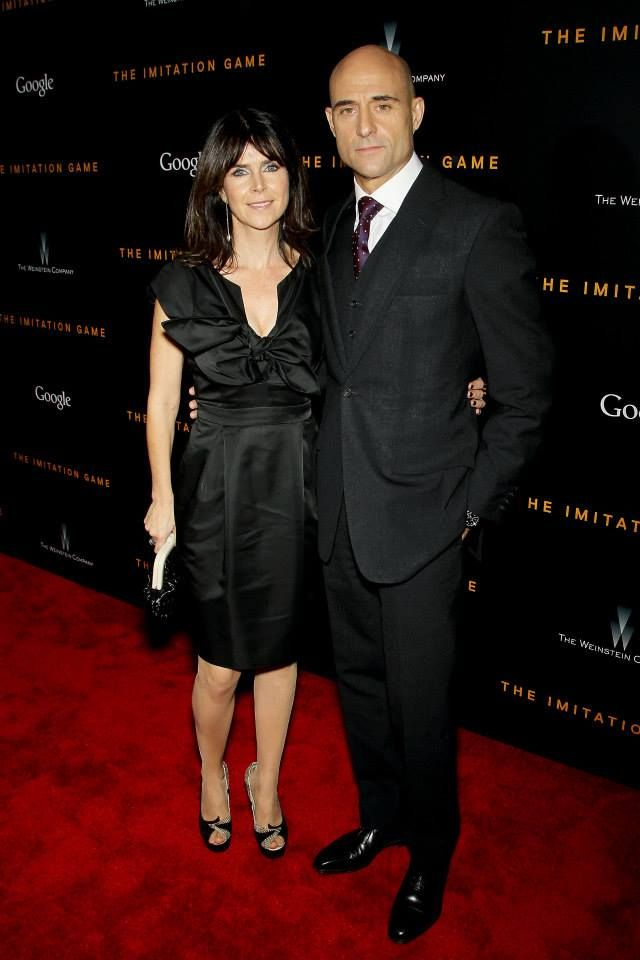 #MarkStrong and his wife Liza Marshall pose together on the red carpet before watching The #ImitationGame.