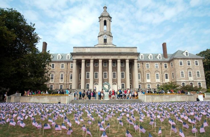 PENN STATE – CAMPUS – Flags on Old Main Lawn at a memorial service Wednesday represented the victims of the Sept. 11, 2001 terrorist attacks. Ten of the victims on that day were Penn State alumni: Kermit Anderson ('65 Sci), Patrick Dwyer ('86 Bus), Michael Ferugio ('87 Eng), Scott Hazelcorn ('94 Bus), Howard Kane ('83 Bus), David Kovalcin ('83, '85 MS Eng), Michele Nelson ('95 Lib), Michael Pescherine ('91, '91 MBA Bus), Jean Roger ('99), David Suarez ('99 Eng)