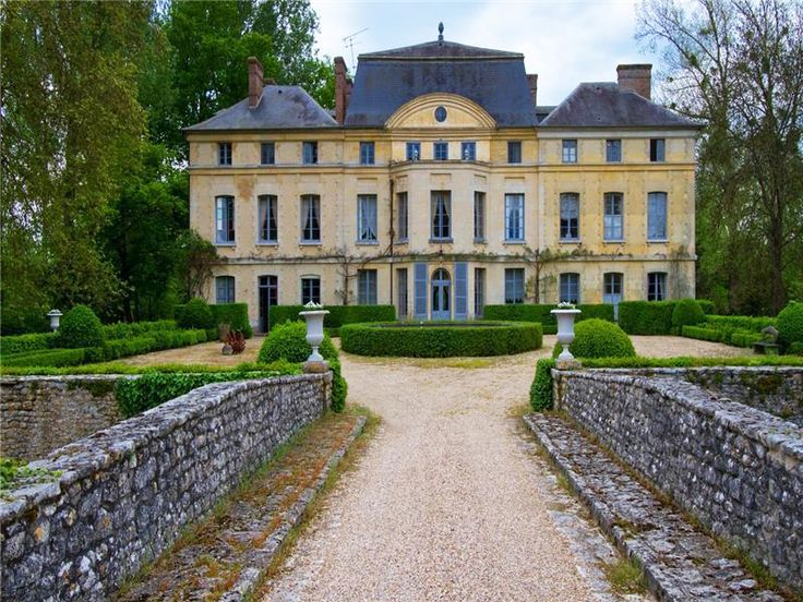 Catherine Deneuve's French Chateau Is For Sale — Take the Tour! // gardens, French gardens, 18th century homes, wine country, stone wall, hedges, boxwood