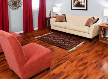 Brazilian Koa Laminate at Lumber Liquidators.  Looks like the real thing but for a tighter budget!