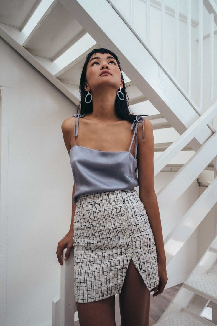 Metallic camisole with a woven button skirt. Definitely something I'd wear.